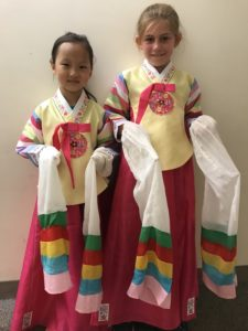 Two young girls in Korean hanbok traditional dresses.